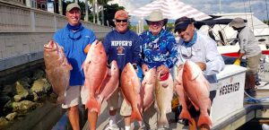 Men Holding Red Snapper | FishyBizness Fishing Charters & Boat Tours in Naples, Florida